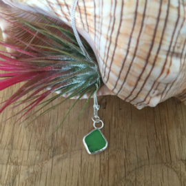 A bright green kite-shaped seaglass necklace with 2 circular jump-rings