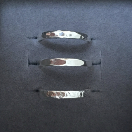 3 rings in a row showing three different finished to seaglass rings: round hammered; flat regular hammered and sharp hammered.