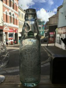 A codd bottle on display at Marmalade Antiques, Falmouth.