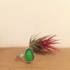 Emerald green seaglass ring made as a bespoke order using the customers own seaglass.