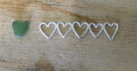 Heather's commissioned bangle. 5 silver hearts attached together, showing a green seaglass heart to the left side.