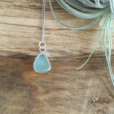 An aqua seaglass necklace, in a droplet shape from Polstreath Beach, Mevagissey.
