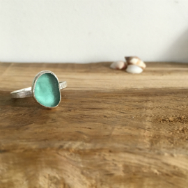Aqua Seaglass ring on a round hammered ring made by Tania in Seaglass Sessions.