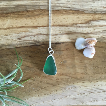 Green-teal seaglass necklace. The seaglass is a rounded tear drop shape.