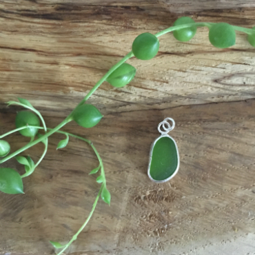 Green seaglass from Nansidwell (Bream Cove/Flat Rocks) in a jelly bean shape, set as a necklace.