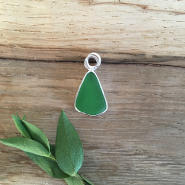 Green Seaglass Necklace from Swanpool beach. It is a teardrop shape and set in silver.