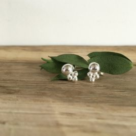 Silver studs Featuring one large silver pebble with three small ones below in a triangle.