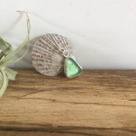 Sage Green Seaglass Necklace - Tuke Beach . Shown in direct sunlight.